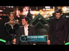 VIDEO: Liam Hemsworth, Josh Hutcherson, and Jennifer Lawrence accept the award for Favorite Movie at the 2013 People's Choice Awards held at Nokia Theatre L.A. Live on 01/09/12.