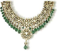 Traditional mughal kundan jewellery, graced by beautiful emeralds and diamonds.