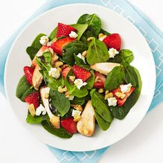 spinach with strawberries, chicken, walnuts and goat cheese. You can toss it all in a balsamic vinegar dressing.