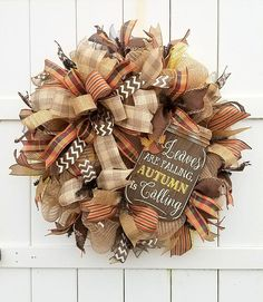 This wreath is full of autumn colors to decorate your front door! This wreath is made with a burlap deco mesh. The accent piece is a wooden mason jar sign that is wired into the wreath for stability. The wreath is adorned with six different ribbons in a variety of fall colors and patterns, including a focal point bow. I added a touch of deco mesh ruffles in brown, copper, and gold. This wreath is made on a 24 inch work wreath. It measures slightly larger, about 28 in diameter. This wreath is…