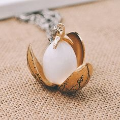 Golden Dragon Egg pendant necklace inspired by Harry Potter//Goblet of... ($40) ❤ liked on Polyvore featuring jewelry