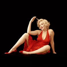 American actress, model and singer Marilyn Monroe playfully poses during the 'Red Dress Series', a series photographed for Life magazine and Greene and Monroe's last collaboration, New York, NY, January 1957.