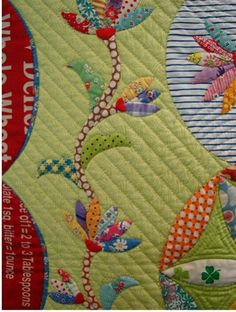 Note slanted quilt lines and use of stripe background