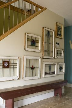 collage of old windows on Wall for display.
