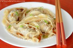 Asian dumplings made with a mixture of pork and chuck, with a dipping sauce.