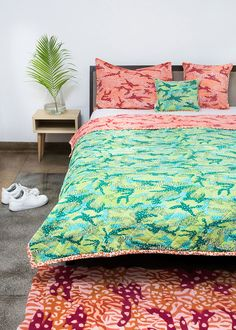 Go wild with vibrant camouflage and animal prints in the bedroom! A modern take on safari inspired interiors, the Big Cat Camo quilt and cushions are from Safomasi's Tiger Safari Collection, and available in 3 sizes.    #bedding #quilt #animalprint #camouflage #pillow #cushion #rug #livingwithpattern #safomasi #safariinspired