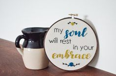 this is a custom made 6 embroidered hoop with a personal design created by randi. this canvas hoop says my soul will rest in your embrace.      a b o u t t h e p r o d u c t     - 6 wooden hoop - lyric wall art - hand-stitched - canvas fabric - black, gold and blue thread - red mahogany stain      p e r f e c t f o r     - home decor - gift      c u s t o m i z e     - custom orders always available!      s h o w s o m e l o v e     - click on the <3 icon and save as a favorite! - add to…