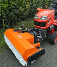 cbfc17dba1a Kersten Sweeper on the front of a Kubota Lawn tractor