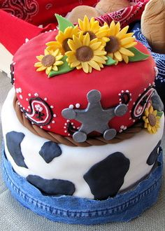 I like the use of the sunflowers on this western cake.  Also like using real denim as the cake board lining to add some extra texture.