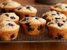 Double Blueberry Muffins : These muffins prove you can never have too many blueberries. A portion of the blueberries is mashed with the back of a fork for a different texture, but the rest are folded into the batter whole for a juicy pop of sweetness. Easily transfer the batter into a muffin tin using an ice cream scoop before sprinkling with cinnamon-sugar.