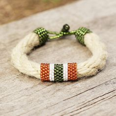 Organic bracelet made of seed beads Toho and thick natural rope. The clasp is also handmade by me, its comfortable and suits the bracelet. The