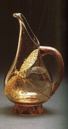 Art Nouveau gold dragonfly vase or pitcher by Emile Galle, Nancy, France. Blown glass, internal inclusions, etched and enameled, with applied gold dragonfly