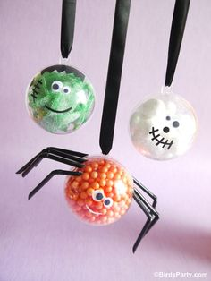 Cute kids craft or candy decor for Halloween using electrical tape and Christmas ornaments!