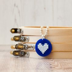 Cross stitch hearts stitched on acrylic. Fun and modern cross stitch!