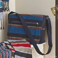 Functional and fashionable, this messenger bag is fully lined, made from cotton canvas with reinforced base and nylon straps