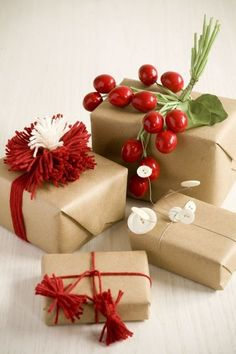 christmas gifts in simple brown paper with embellishments