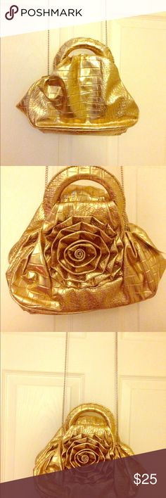 """✨🌼Shiny Gold Flower Handbag🌼✨ ✨🌼Shiny Gold Flower Handbag🌼✨ H: 6"""", W: 10.5, D: 5.5"""", silver accents, smooth patterned texture, magnetic closure, has three zipper compartments with patterned cloth interior with additional zipper pocket inside and other flap pocket for storage. Pretty roomy for a smaller bag. Great for a night out on the town🌼✨ Bags Shoulder Bags"""