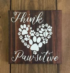 """""""Think Pawsitive"""" paw print heart reclaimed wood sign. Measures 8""""x8"""" Hand painted, no vinyl stickers, and varnished so it's made to last. As with all our signs, this item is completely customizable. Just shoot us a message and we can customize the colors and size. Check out all of our adorable doggy signs in the """"Paws for a Cause"""" section of our shop! 40% of all proceeds from this section of our shop go to local no-kill shelters, rescue group and rescue efforts in the Houston and…"""
