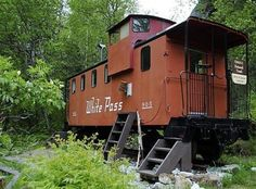 Yukon and White Pass Railroad Steel caboose somewhere in Alaska. It is used by hikers to overnight in. The railroad is a narrow gauge railroad...