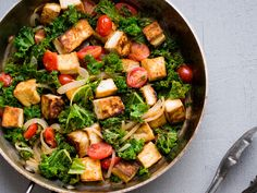 Tofu, Kale & Cherry Tomatoes in White Wine Sauce | For this quick vegetarian meal, kale and cherry tomatoes are simmered in a white wine sauce before adding crispy tofu.