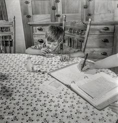 """Shorpy Historic Picture Archive :: Hard Licker: 1942 ~ July 1942. East Montpelier, Vermont. """"Richard, age 5, son of the farmer Charles Ormsbee, has his own war project -- he has agreed to lick all the savings stamps for the family."""" Photo by Fritz Henle, Office of War Information."""
