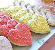 ©Coco Paloma Desserts. Decorated sugar cookies - hearts with folk art designs.