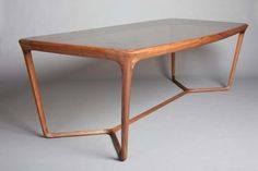 - A WALNUT AND SMOKED GLASS OBI DINING TABLE BY CECCOTTI,