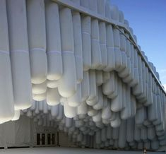Bundles of giant white inflatable sausages make a big visual impact on the exterior walls of the Design Miami tent at Art Basel. New York studio Skarnitecture covered the structure in vinyl tubes bundled together at varying heights for a result that's highly unusual, to say the least.