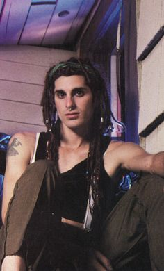 Perry Farrell  GAWD! How old is this!?!? He looks like a littel kid!