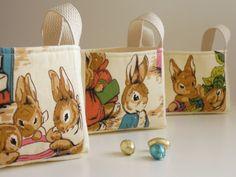 "SET of 3 Peter Rabbit Baskets - for a Boy, Girl, Nursery - Vintage Beatrix Potter Peter Rabbit Fabric Bin - 6"" x 4.5"" x 5"". $165.00, via Etsy."