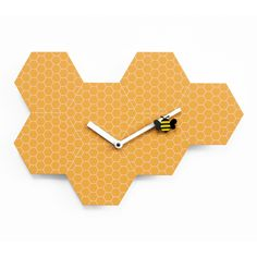 Excellent modern high-end designer orange and white honeycomb analog wall clock with bee on minute hand.
