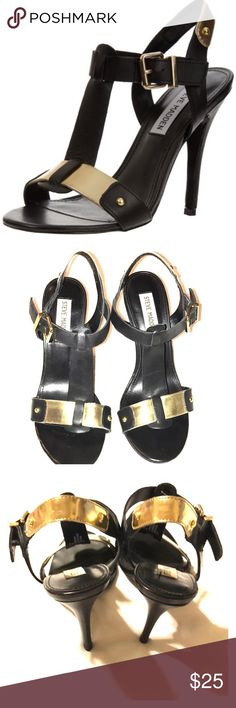 Steve Madden Reya Heels Shiny hardware adds a chic touch to these Reya leather high-heel sandals from Steve Madden. The leather sandals feature a T-strap, side adjustable buckle closure, shiny hardware and a stiletto heel. Fits true to size  A wide T-strap connects architectural lines and gold accents in this Steve Madden Steve Madden Shoes Heels