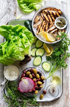 (Omit yogurt, oil and olives; use 1 1/2 pounds chicken to serve 6) Mediterranean Chicken Salad Lettuce Wraps - simple and fresh.