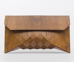 Handmade extra-large clutch constructed from 100% imbuia (emboya) wood, which is a vibrant, fine textured wood, prized by woodworkers. http://www.zocko.com/z/JIPWo