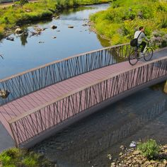 STREETLIFE Bowie Coated Bridge. Pedestrian Bridge with CrissCrossed Balusters. The FSC® Hardwood handrail frames the fence and exudes a warm feel for those crossing the bridge