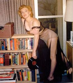 Harold Lloyd - Marilyn Monroe -  January 1952) - posing in lingerie, holding a record album - taken during a photo shoot at Marilyn's Los Angeles apartment by Philippe Halsman