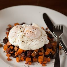 An easy to make Fall breakfast with sweet potatoes, bacon, onion, rosemary, and perfectly cooked poached eggs.