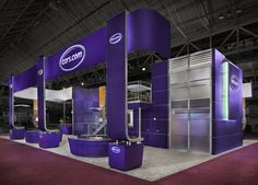 This custom built, Cars.com exhibit was created by MG Design, with a relatively open design to put the focus on the brand and the message.  MG Design: Trade Show Exhibits, Events, Environments, Experiences.  www.mgdesign.com