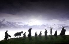 """The Fellowship on its journey - this silhouette is cropped from a huge panorama in the film, that shows them all dwarved by the spectacular ancient mountain ranges along the horizon.  """"Dwarfed"""" haha"""