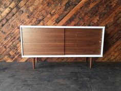 Custom Mid Century Style White Lacquer Walnut Credenza  newly made, white lacquer, walnut wood, sliding doors, interior shelving  Length:55 Depth:18 Height:30  $350 is partial payment for full shipping fee to be calculated after sale