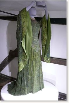 The Archaeology of a Dress. A dress decorated with 1,000 real beetle wings is set to go back on display following 1,300 hours of conservation work. A stage costume worn by Ellen Terry, one of the most celebrated and glamorous actresses of the Victorian age. The emerald and sea green gown, covered with the iridescent wings of the jewel beetle (which they shed naturally), was worn by Ellen when she thrilled audiences with her portrayal of Lady Macbeth at London's Lyceum Theatre in 1888.