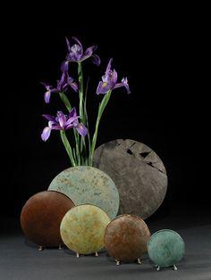 five round vases: spare, elegant, lean and superb