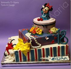 Minnie Mouse Cake  http://www.facebook.com/photo.php?fbid=213545188707898=pb.213362848726132.-2207520000.1362161803=3=https%3A%2F%2Fsphotos-b.xx.fbcdn.net%2Fhphotos-ash4%2F332279_213545188707898_1767718632_o.jpg=https%3A%2F%2Fsphotos-b.xx.fbcdn.net%2Fhphotos-ash4%2F311737_213545188707898_1767718632_n.jpg=1018%2C990      http://betweenthepagesblog.typepad.com/between-the-pages-blog/2011/10/gorgeous-minnie-mouse-cake.html