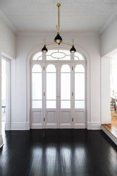 white entryway door with black floors