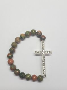 A silver pave cross is paired with Unakite beads in this elegant piece of strength and faith. *All designs can be altered using the beads of your choice. Miy'Couture is a fluid company and we will work with you to create your heart's desires. All Design, Camouflage, Natural Gemstones, Create Yourself, Beaded Bracelets, Couture, Beads, Silver, Jewelry
