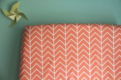 fitted crib sheet in coral chevrons exclusive to by iviebaby, $55.00  i like the wall color and fabric