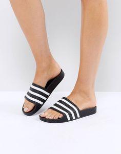 7f4a46989058 adidas Originals Adilette slider sandals in black at asos.com