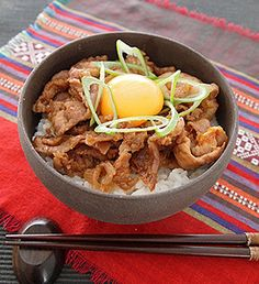 Ginger Grilled Bowl of Pork _ topped with egg & green onion.