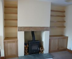 Built-in wooden shelves and cabinets and a TV instead of wood burning fireplace