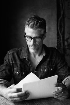 sexy man, in glasses, reading